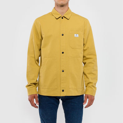 Mustard yellow shirt jacket in a coarse cotton fabric.