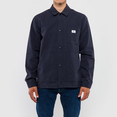 Navy blue shirt jacket in a coarse cotton fabric.