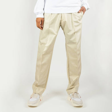 Cream laidback pleated trousers.