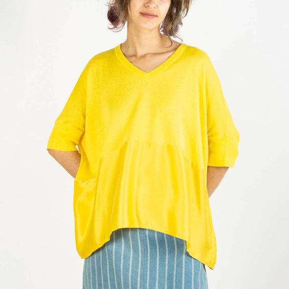 Yellow relaxed fit knitted v-neck top with silk panel.