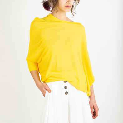 Yellow draped top with fitted cuffs and waist.