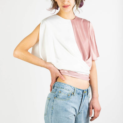 Two-tone satin wrap top with tie waist and split sleeves in dusty pink and white.