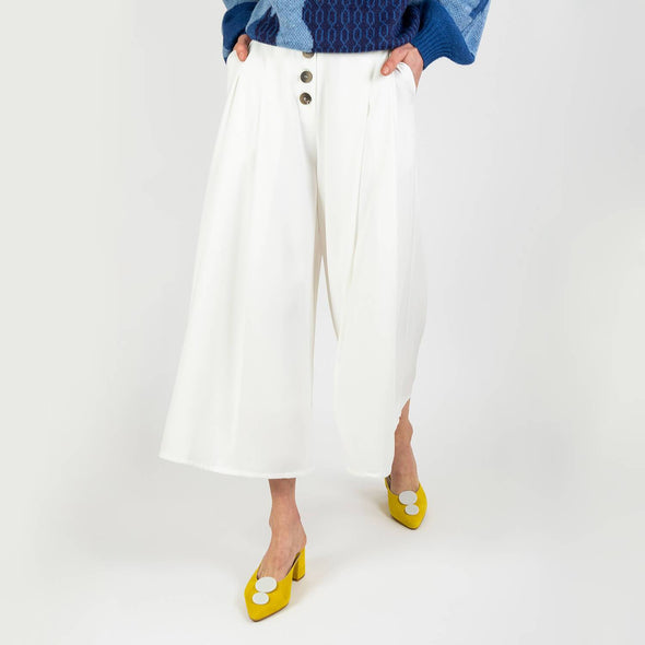 White culottes with wide floaty legs, pleated front and button details.