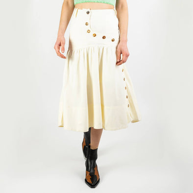 Rustic linen skirt with button down details. Crafted with a curved button stand, side pockets and a western style yoke.