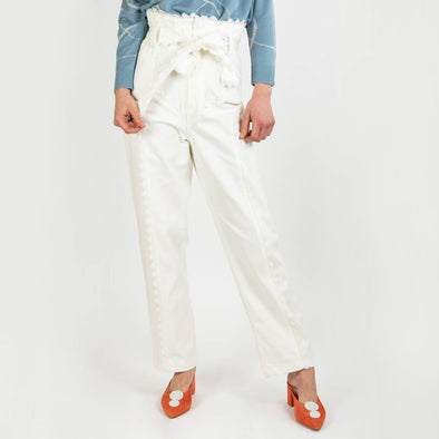 High waisted white denim paper bag trousers with a prairie trim and pearl button.