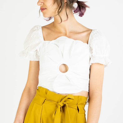 Pearl white crop top with ruffle sleves and detailed front.