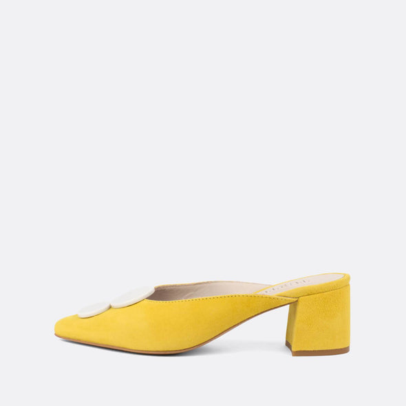 Vintage style yellow suede heeled mules with white details.