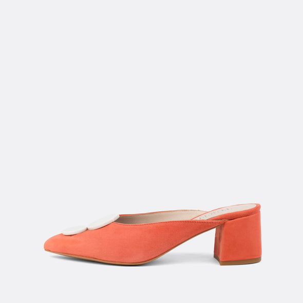 Vintage style carrot suede heeled mules with white details.