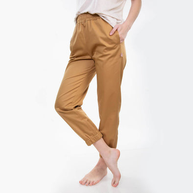 Yellow loose fit trousers with normal waist and cropped length.
