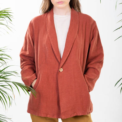 Terracota hip length blazer with oversized cut, hidden pockets and a small shawl collar.