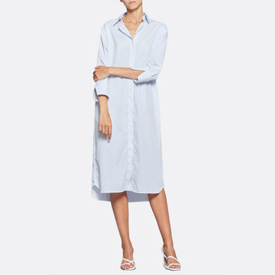 Long blue striped overshirt dress featuring 3/4 sleeves and side pockets.