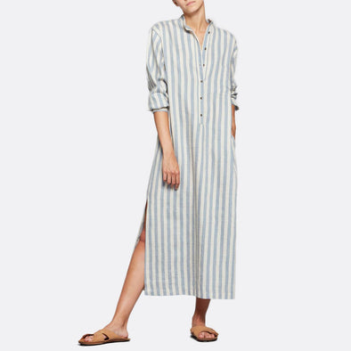 Long overshirt dress featuring long sleeves and soft blue stripes.
