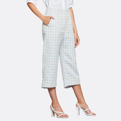Light blue high waisted culottes in cotton and polyester jacquard, featuring different lengths at the front and back.