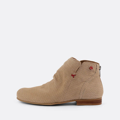 Beige perforated leather boots.