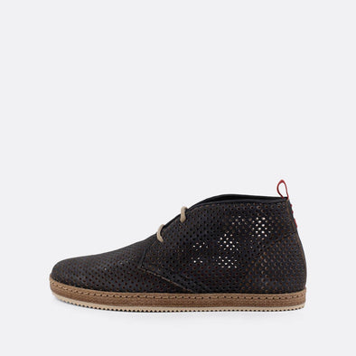 Black perforated leather shoes with beige laces.