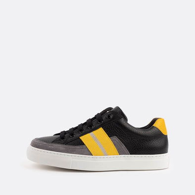 Black low-top sneakers with pops of color in grey and yellow.