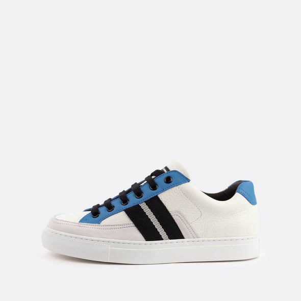 White low-top sneakers with pops of color in black and blue.