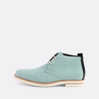 Mint suede chukka boots with black backstay.