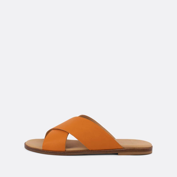 Cross-strap slides in orange leather.