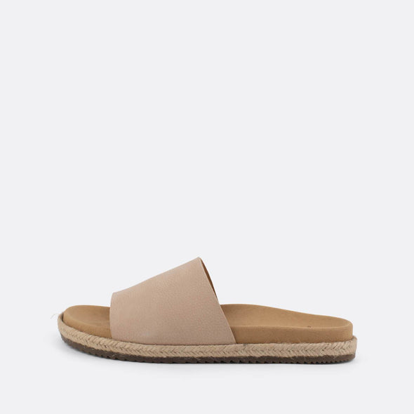 Nude leather one-strap slides with raffia sole.