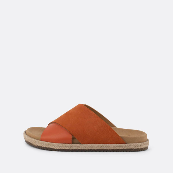 Cross-strap slides in orange leather with raffia sole.