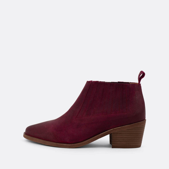 Bordeaux suede heeled ankle boots.