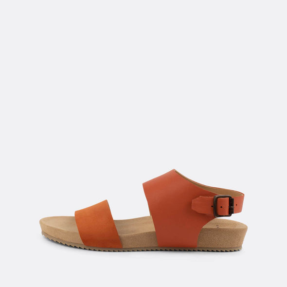 Double-strap sandals in orange leather.