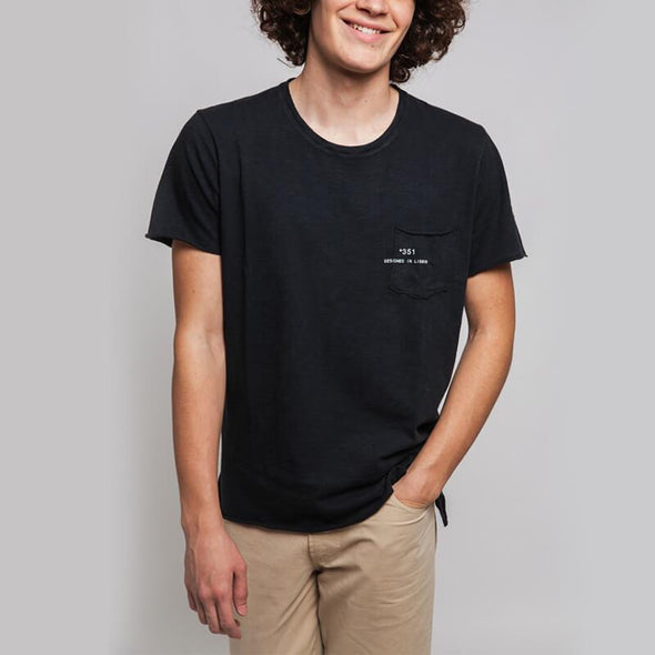 Black round neck t-shirt with small pocket on the front and +351 logo print.