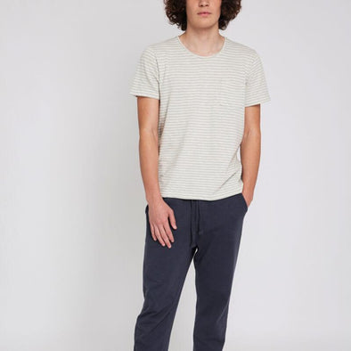 Ecru striped round neck t-shirt with small pocket on the front.