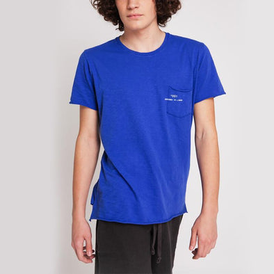 Blue round neck t-shirt with small pocket on the front and +351 logo print.