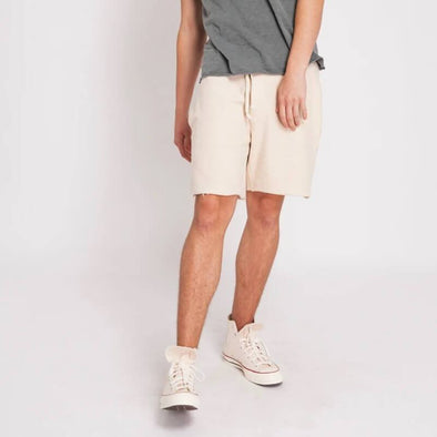 Beige above the knee walkshorts in a rustic textured cotton-blend.