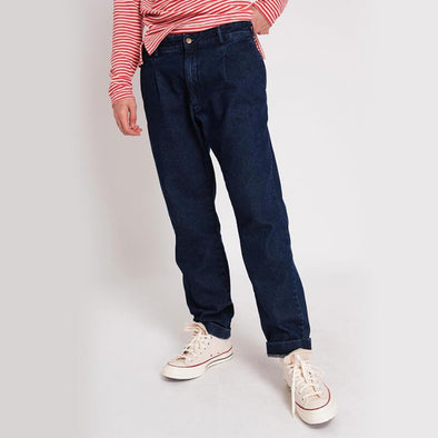 Blue pleated jeans with zip fly and top button in the front.