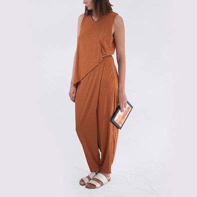 Caramel catsuit with high V-neck, crossed back straps and overlapped detailing at the front.