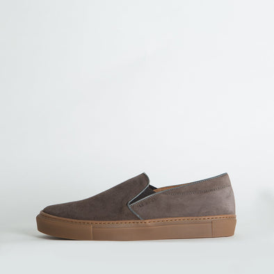 Taupe suede slip-on sneakers with natural rubber soles.