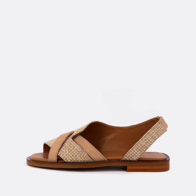 Beige neutrals cross leather sandals with open toe and texture.