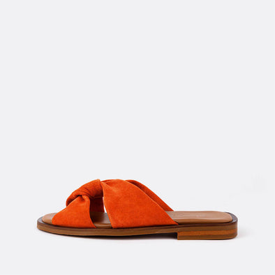 Orange leather slides with braided detail.