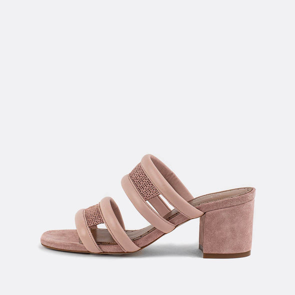 Pink leather perforated heeled mules.