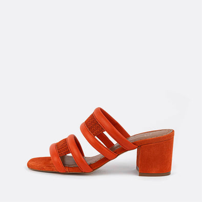 Orange leather perforated heeled mules.