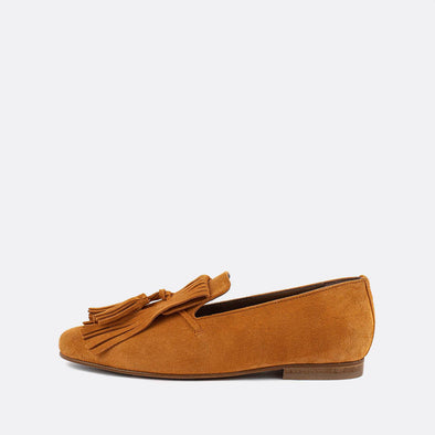 Yellow suede flat loafers with round toe and fringe applique.