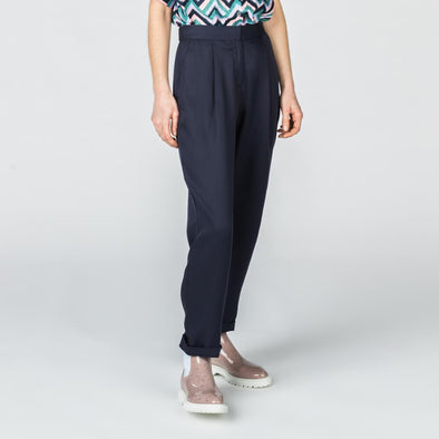 Navy blue straight cut high waisted pants with side pockets.