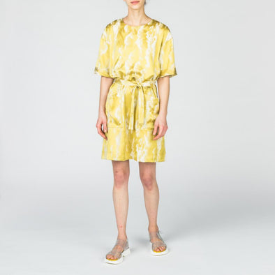 Yellow patterned dress with two front pockets and a belt to tie at the waist.