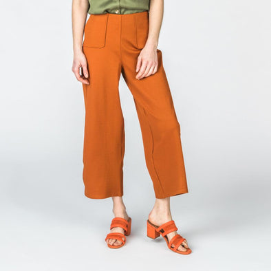 Rust loose-fitting high-waisted pants with two side pockets.