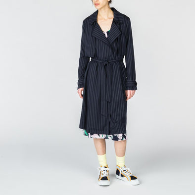 Navy blue trench coat with thin white stripes.