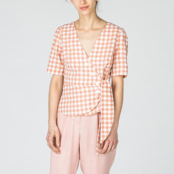 Vichy wrap-top with white buttons.
