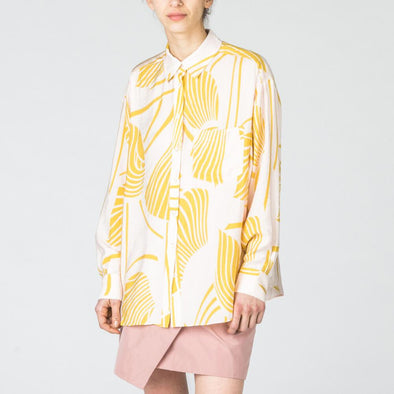 Beige long sleeved shirt with yellow abstract print.