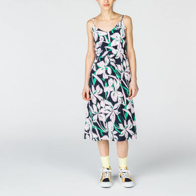Navy blue midi dress with flower print in shades of green and baby pink.