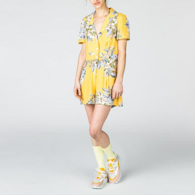 Yellow playsuit with flower print.
