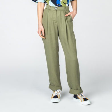 High waisted olive green trousers with side pockets.