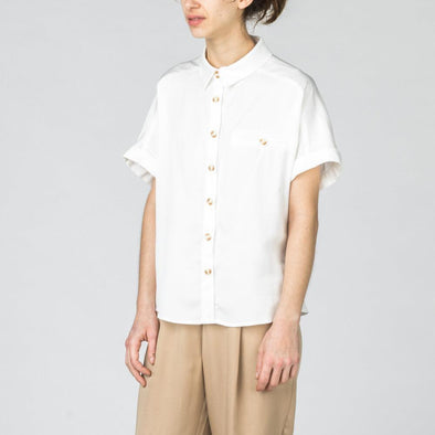White shirt with short rolled up sleeves.
