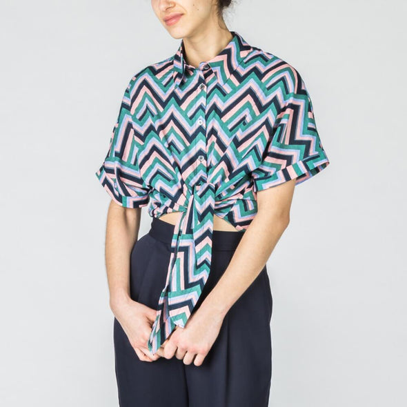Zig-zag shirt with short rolled up sleeves.